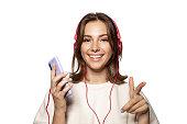 istock Pretty lady holding modern smartphone 1185101914