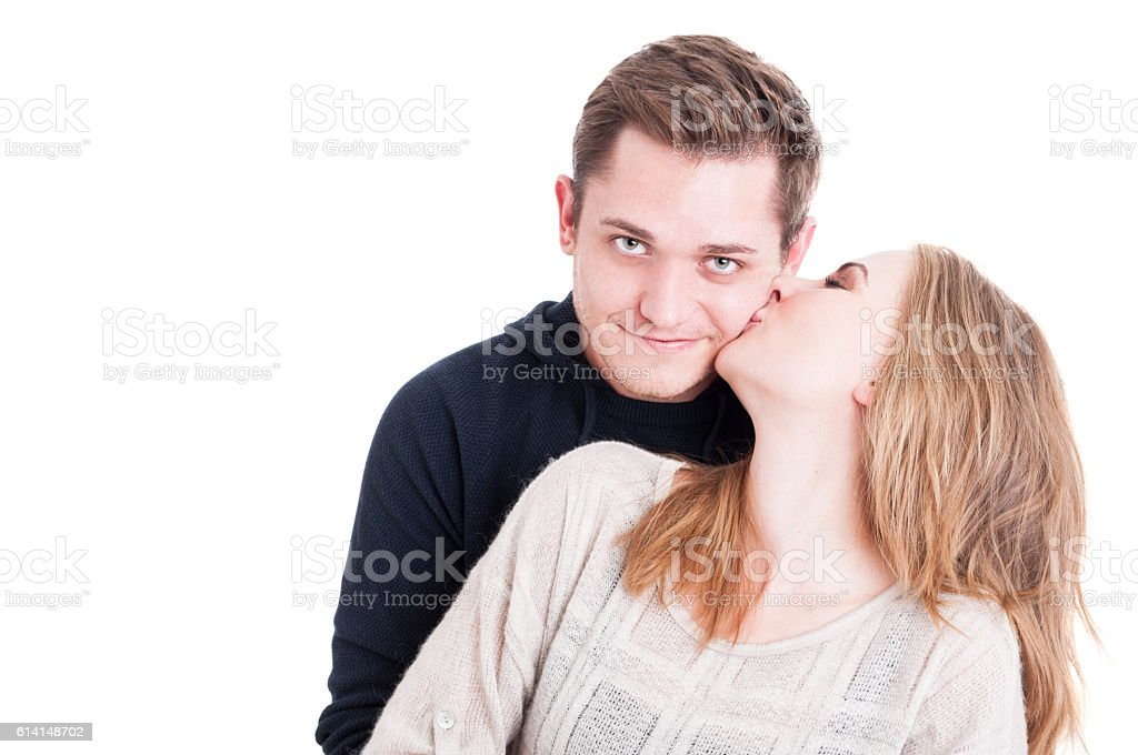 Pretty lady kissing on cheek her sweetheart stock photo
