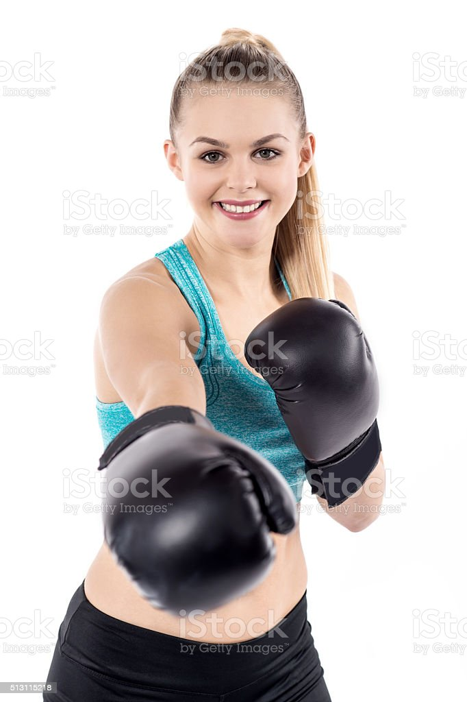 Pretty lady working out wearing boxing gloves royalty-free stock photo