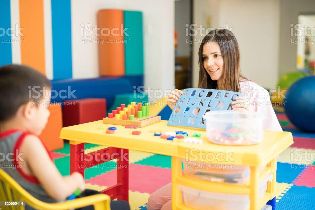 Pretty language therapist at work stock photo