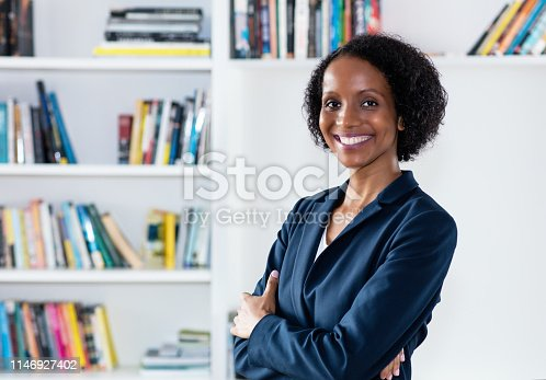 istock Pretty laughing african american businesswoman 1146927402