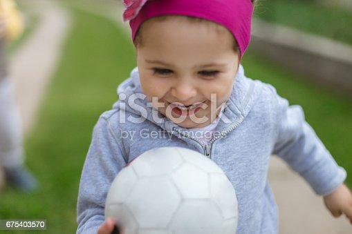 678589610istockphoto Pretty little girl and her ball 675403570
