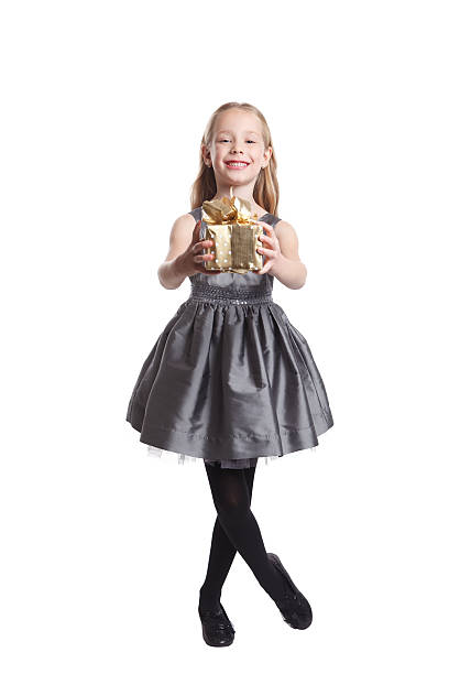 pretty little girl giving a present - little girls giving head stock photos and pictures