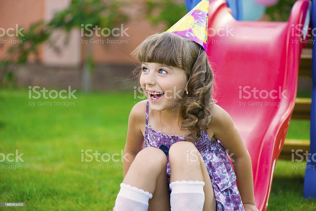 Pretty little girl having fun on playground royalty-free stock photo