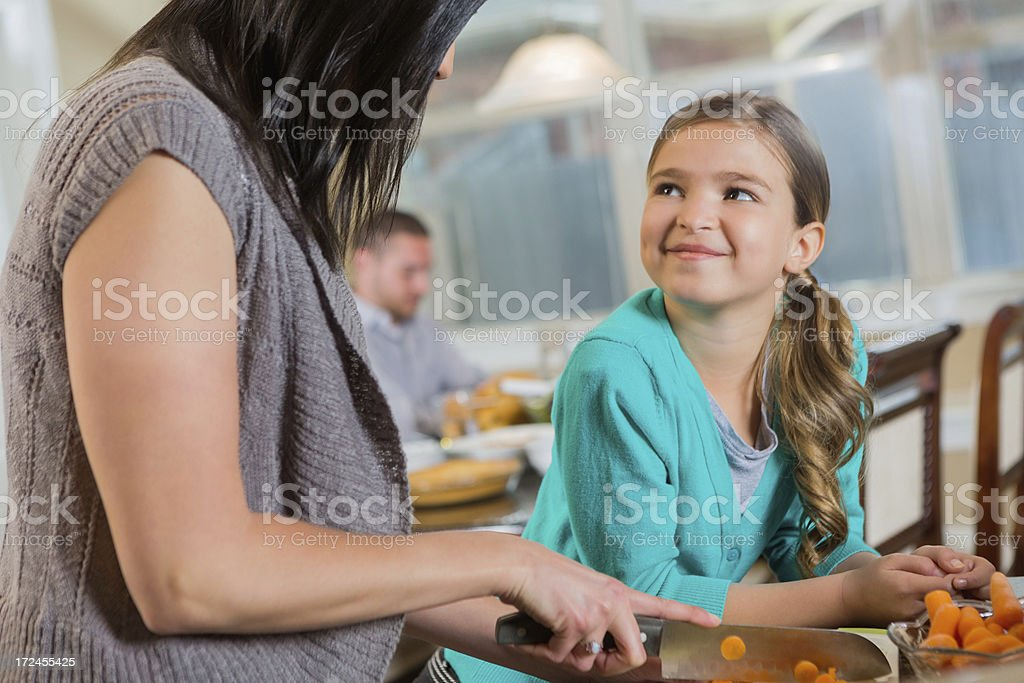 Pretty little girl helping mother prepare a healthy meal royalty-free stock photo