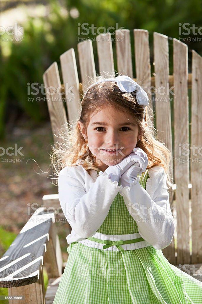 Pretty little girl in green dress stock photo