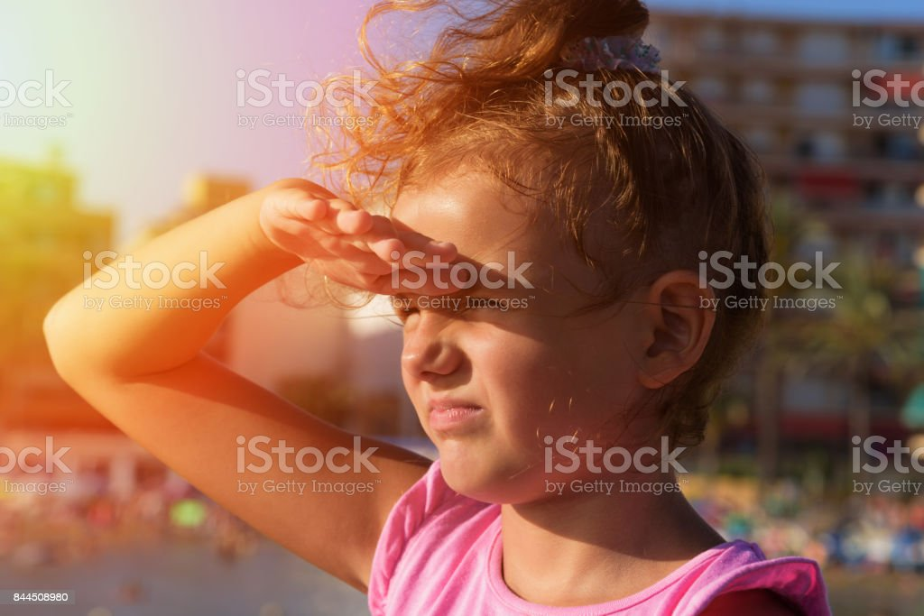 A Pretty Little Girl Looks Far Away From Right To Left Side