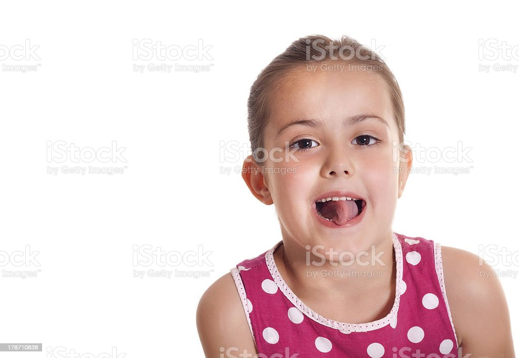 pretty little girl making a funny faces stock photo