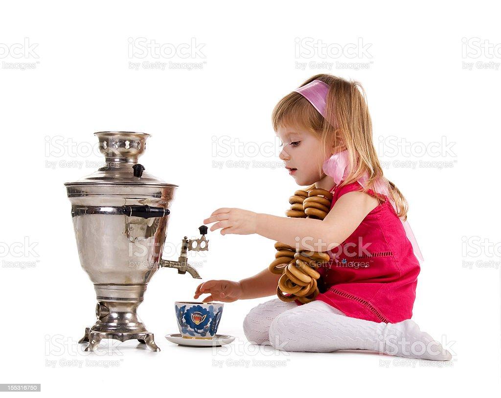 Pretty little girl near the samovar royalty-free stock photo
