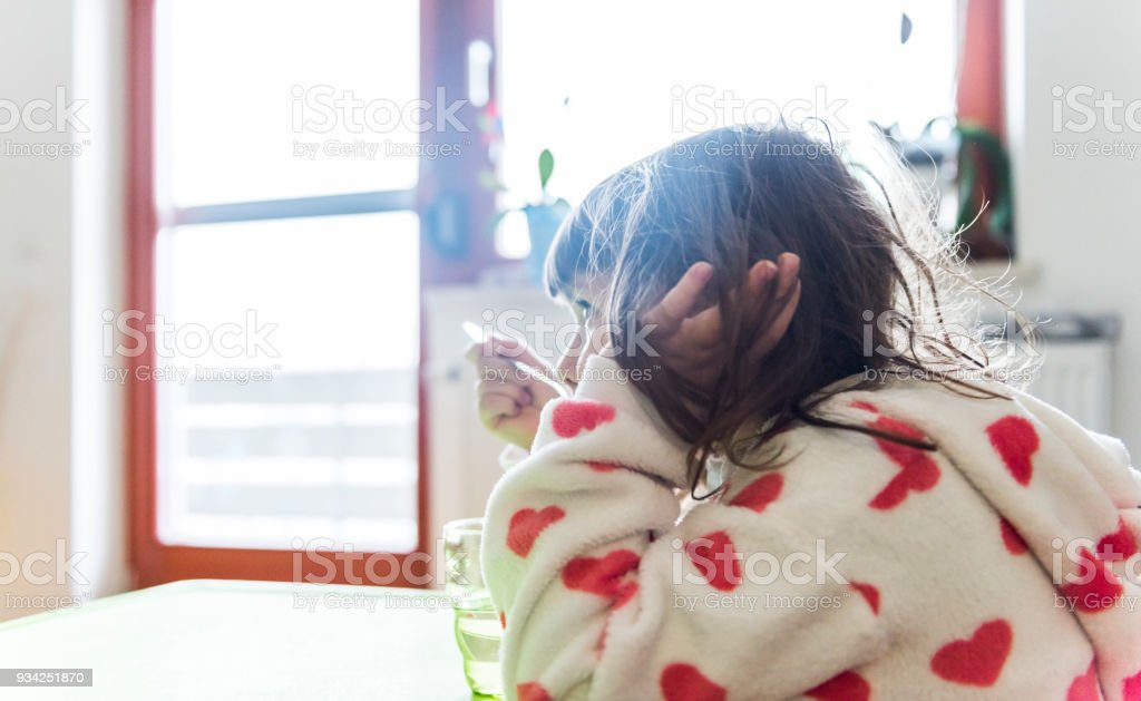 Pretty little girl watching TV stock photo