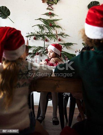 istock Pretty little girl wearing a santahat 881480892