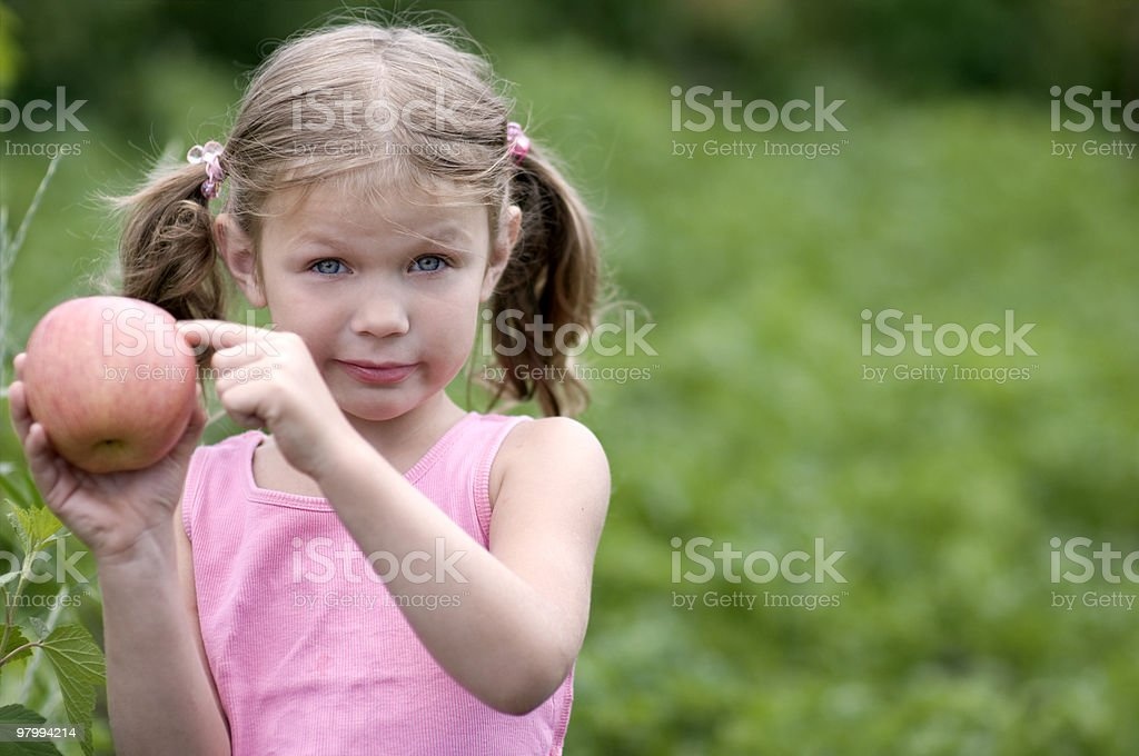 Pretty Little girl with a Apple royalty-free stock photo
