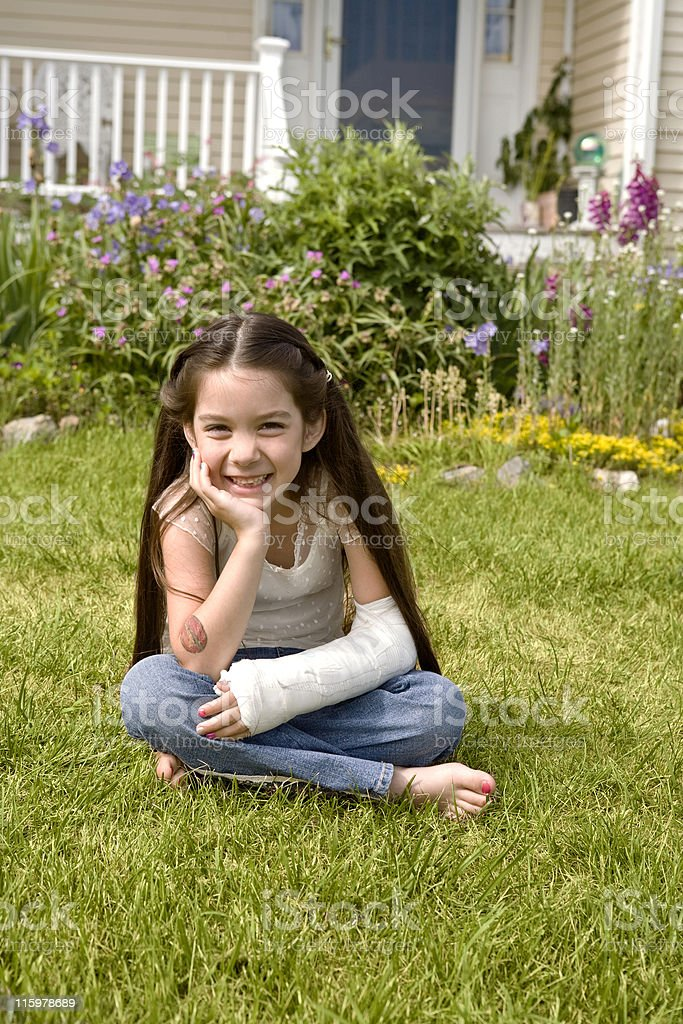 Pretty Little Girl with a Broken Arm royalty-free stock photo