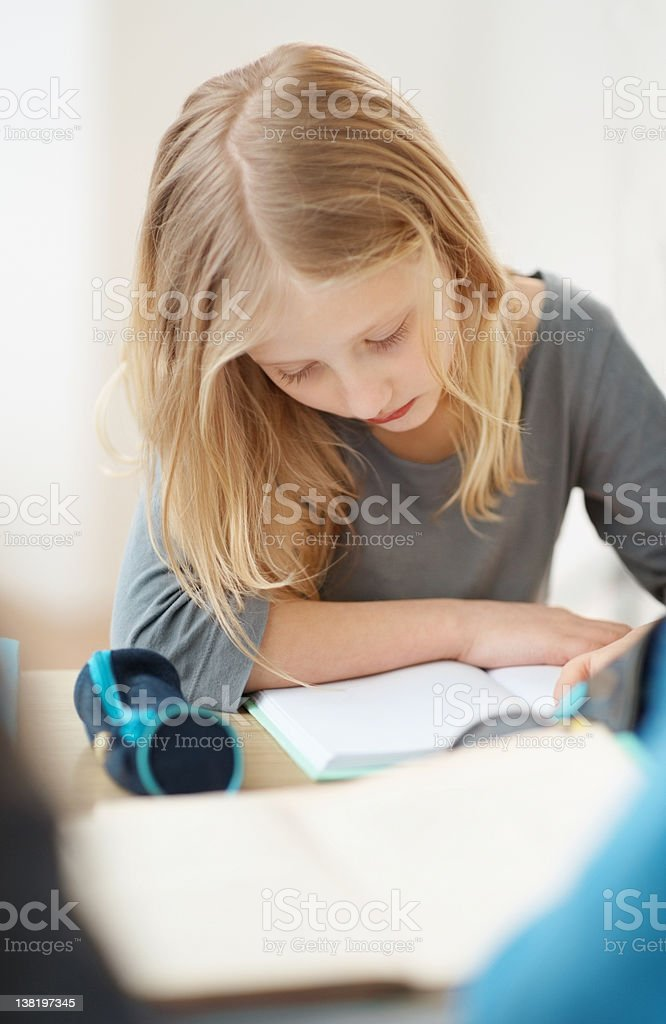 Pretty little school student preparing for her exams royalty-free stock photo