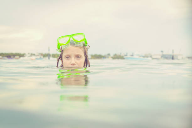 Girl Snorkeling Stock Photos, Pictures & Royalty-Free