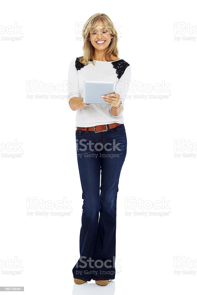 Pretty mature lady working on tablet computer stock photo