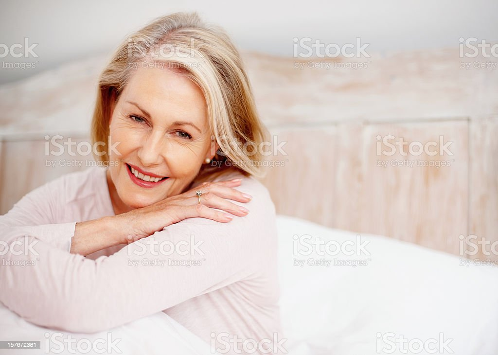 Pretty, mature woman giving you a cute smile royalty-free stock photo