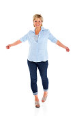 istock Pretty mature woman looking happy on white 179650033