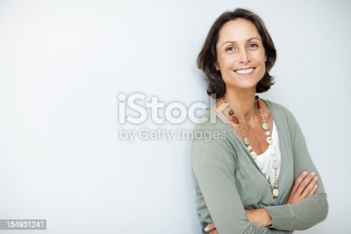 istock Pretty, mature woman standing with her hands folded 154931241