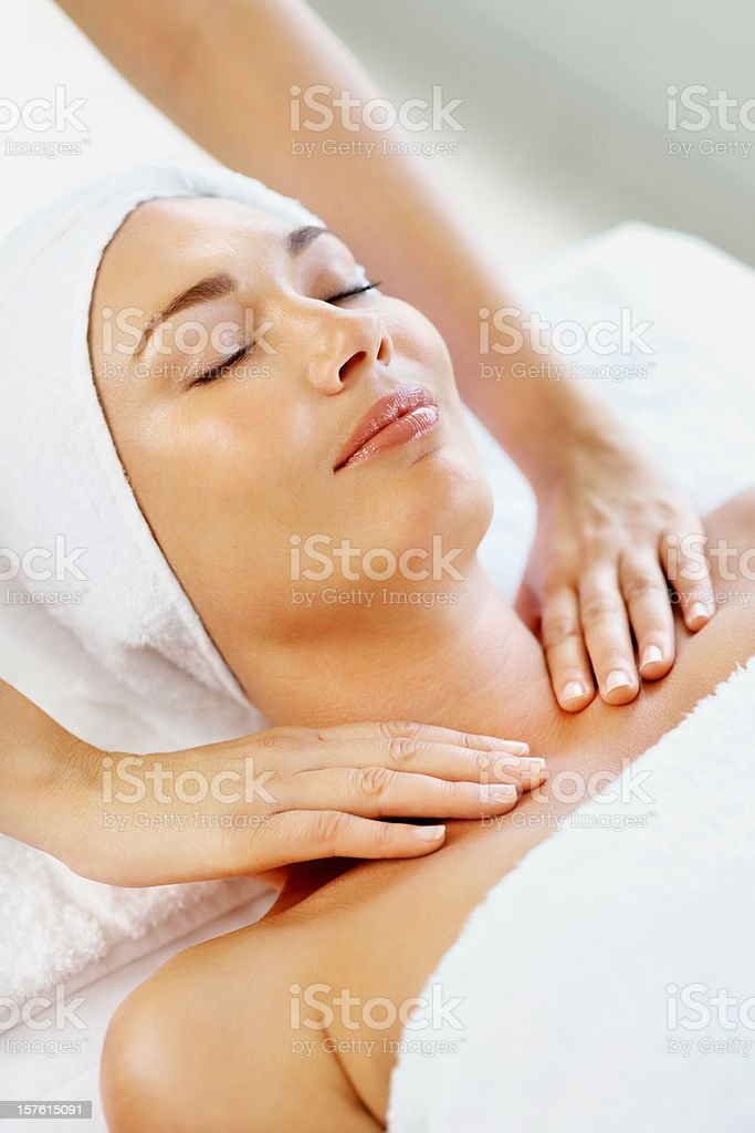 Pretty mid adult lady receiving shoulder massage at spa royalty-free stock photo