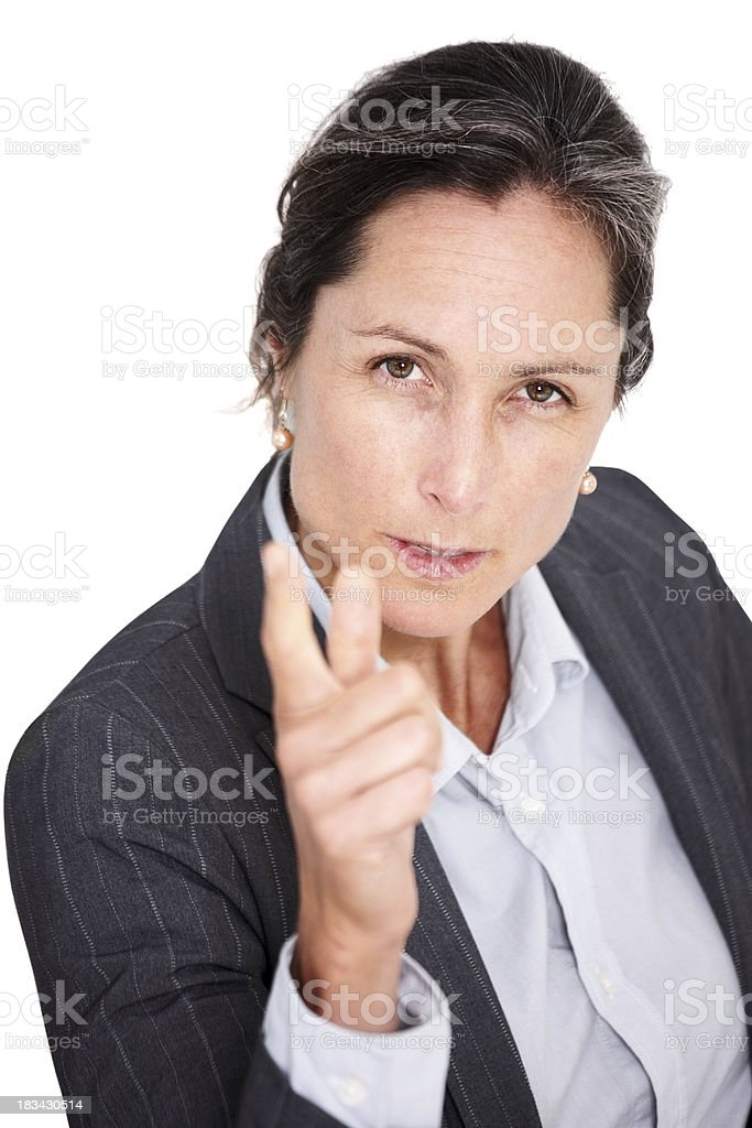 Pretty middle aged businesswoman pointing at camera royalty-free stock photo