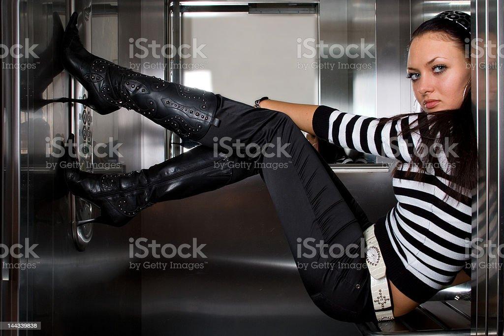 pretty model in black boots stock photo
