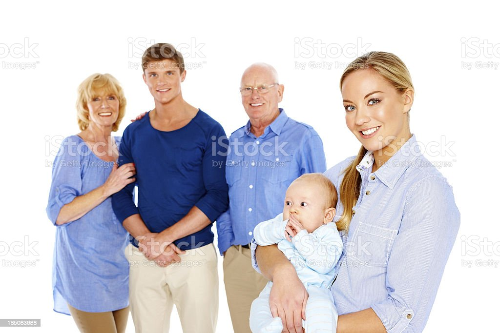 Pretty mother with her son and family in background royalty-free stock photo