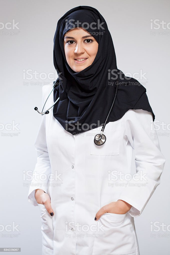 Pretty muslim doctor stock photo