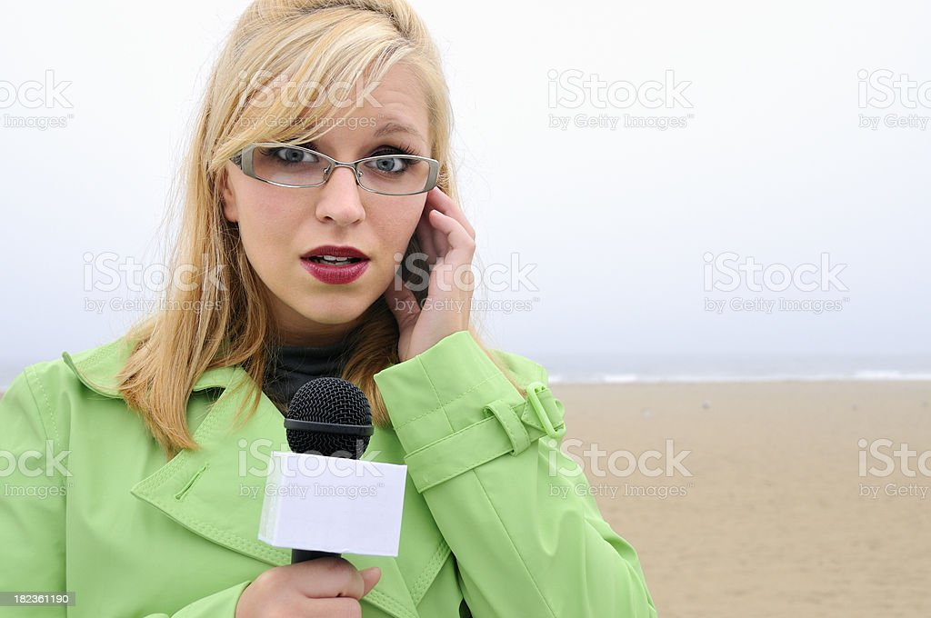 Pretty News Reporter with Surprised Look stock photo