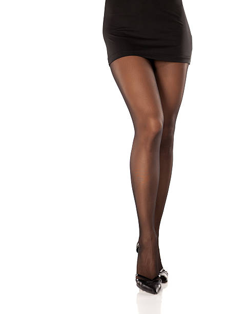 pretty, nice cared feminine legs in short dress, nylon - black women wearing pantyhose stock photos and pictures
