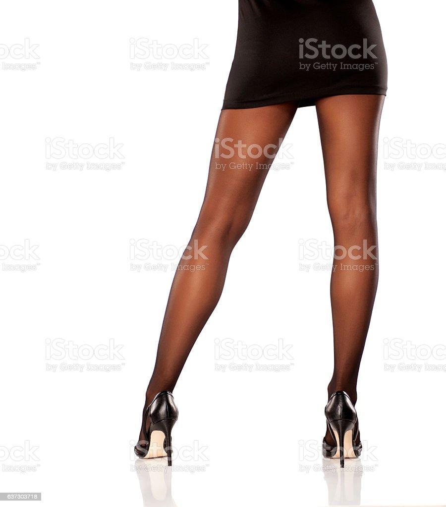 pretty, nice cared feminine legs in short dress, nylon stock photo