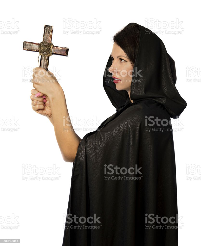 Pretty nun looking at cross stock photo