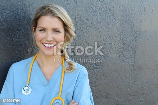 istock Pretty nurse in uniform smiling at camera 629994764