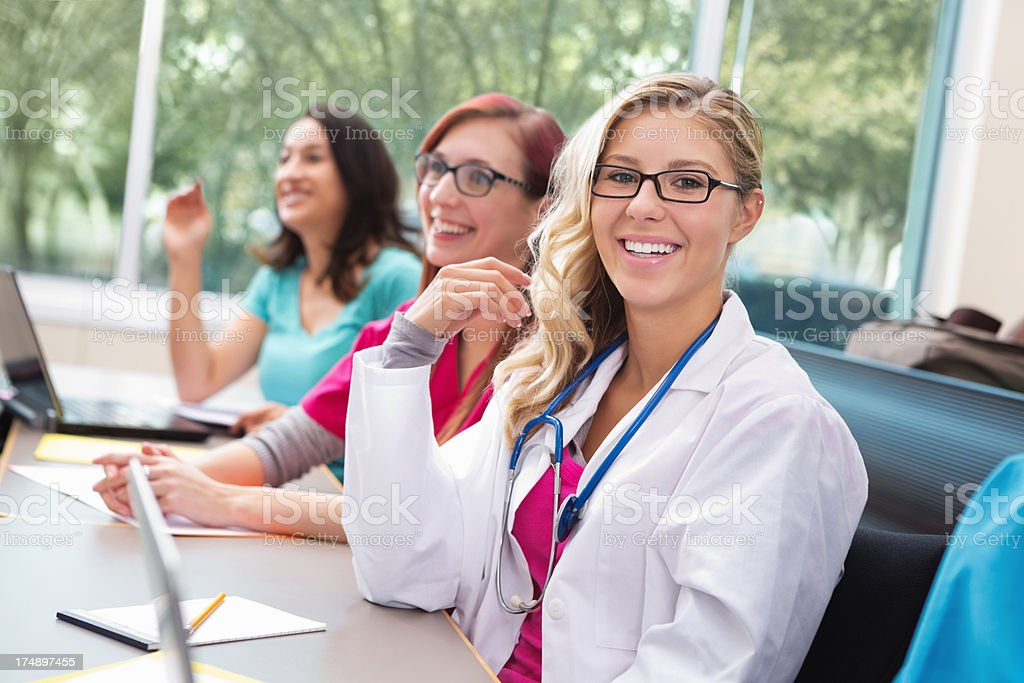 Pretty nursing or medical students in college classroom royalty-free stock photo