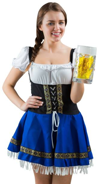 pretty oktoberfest girl smiling at camera holding beer - bier kostüm stock-fotos und bilder