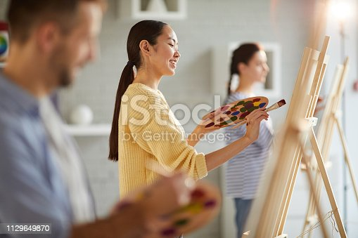 824254912 istock photo Pretty painter 1129649870
