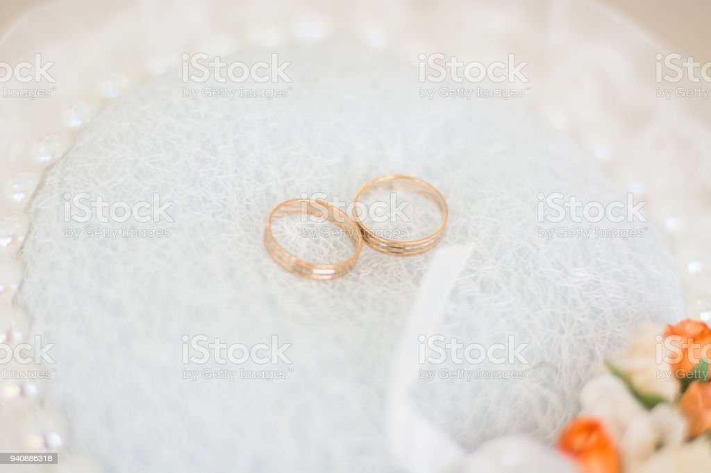 pretty Pincushion for storing engagement rings, wedding newlyweds. the symbol of eternal love in the ring. stock photo