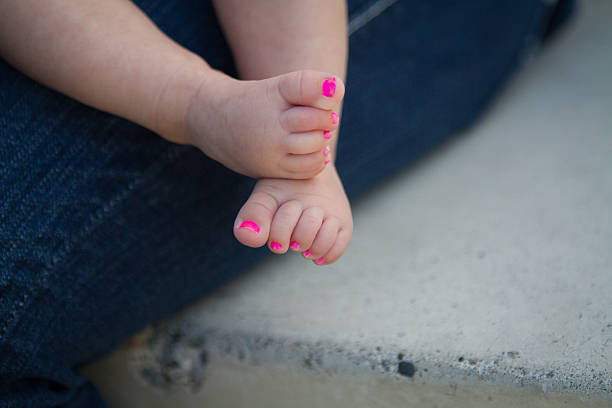 Pretty, pink baby toes. Baby girl feet with pink painted toe nails. neicebird stock pictures, royalty-free photos & images