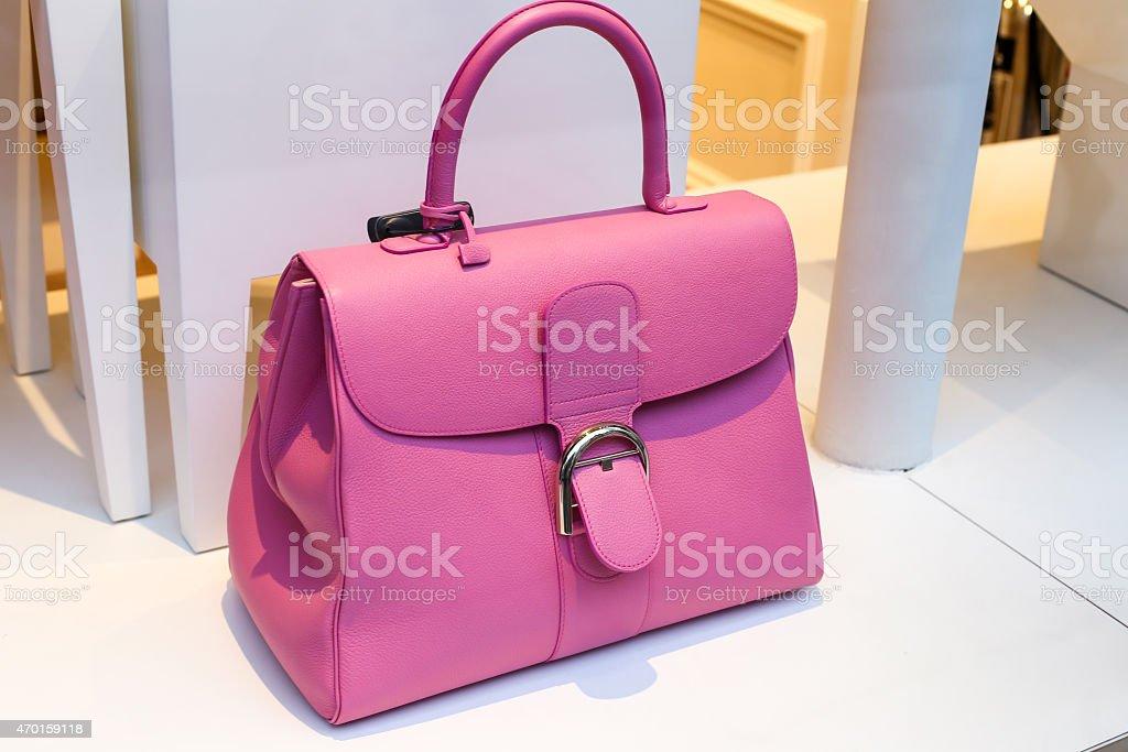 Pretty pink lady's handbag on the shop display stock photo