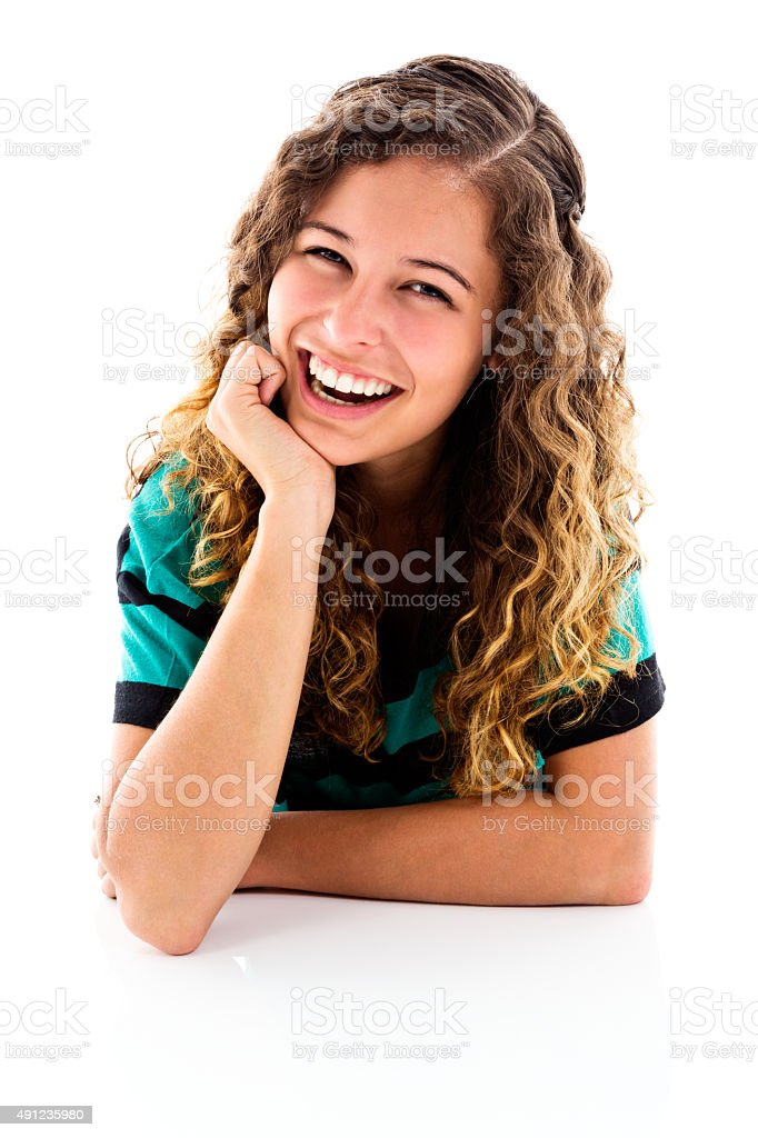 Pretty portrait of smiling young woman resting on elbows. Isolated. stock photo
