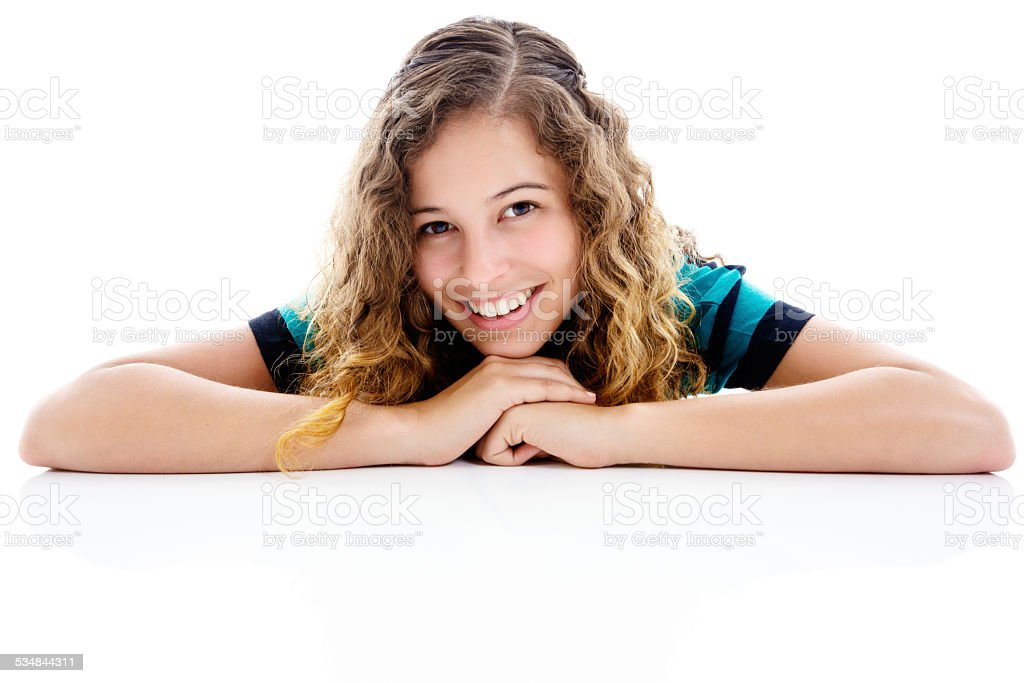 Pretty portrait of young woman resting on elbows. Isolated. stock photo