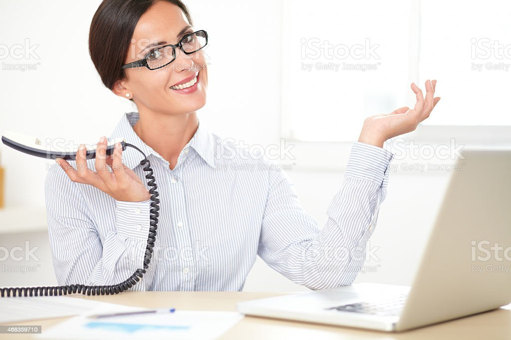 Pretty professional employee speaking on the phone royalty-free stock photo
