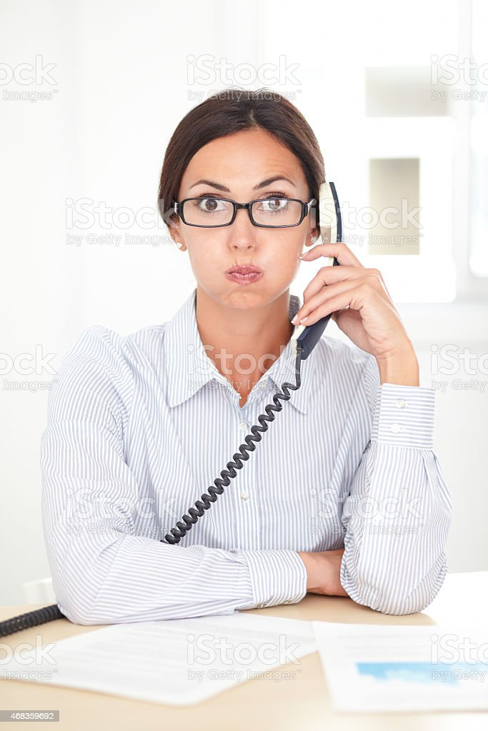 Pretty receptionist calling on the phone royalty-free stock photo