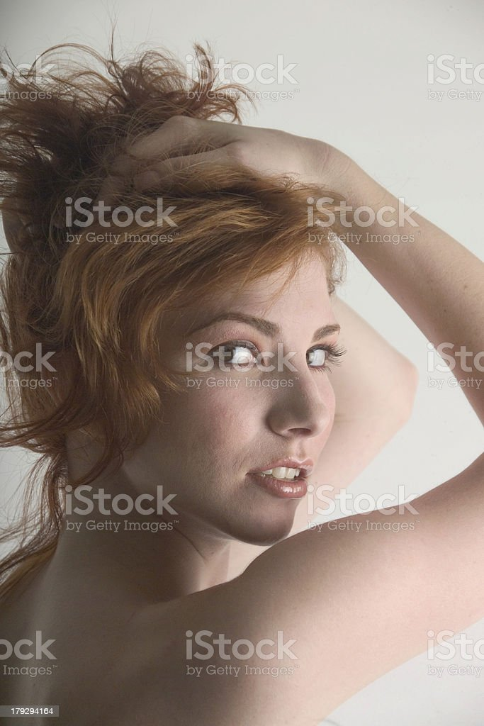Pretty redhead lifting her hair royalty-free stock photo