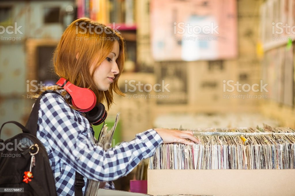Pretty redhead searching a vinyl stock photo