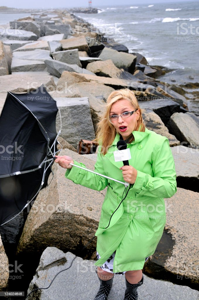 Pretty Reporter Comments on Raging Ocean Storm stock photo