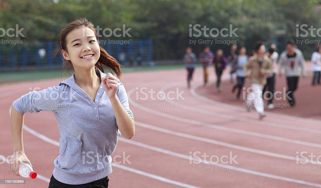 pretty school girl running stock photo