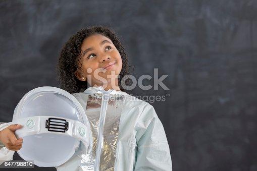 istock Pretty schoolgirl in astronaut costume 647798810