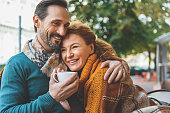 istock Pretty senior lovers hugging with joy 627312940