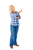 istock Pretty senior woman pointing at copyspace 497080987
